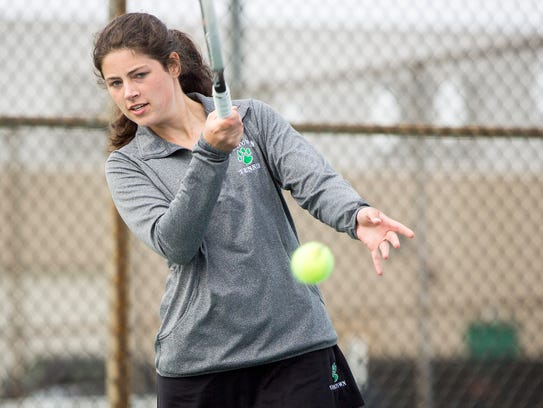 Meghan Stevens hits the ball during her doubles match