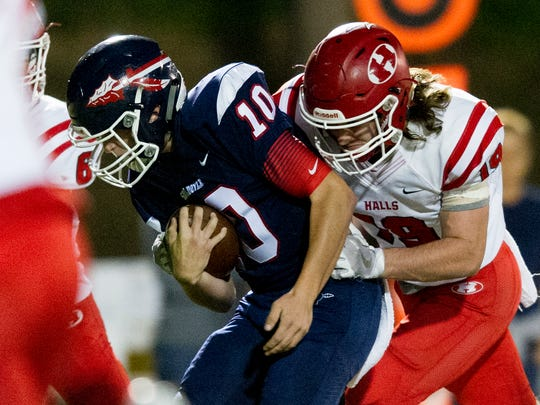 South Doyle's Mason Brang (10) runs the ball as Halls' Hunter Huff (19) tackles during a game between South Doyle and Halls at South Doyle High School in Knoxville, Tennessee, on Friday, October 6, 2017.