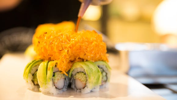 A volcano roll is made at Rock-n-Sake in River Ranch.