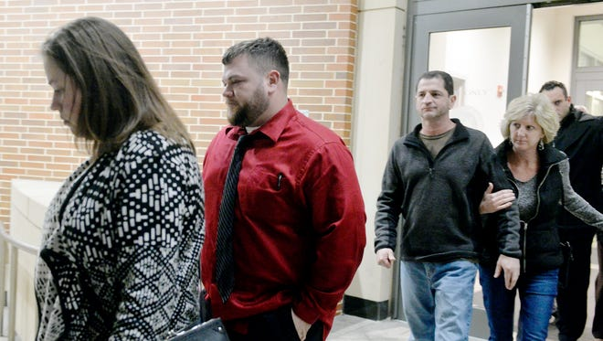 Former York County Prison guard David Whitcomb, 30 of Hellam Township, second from left, leaves the York County Judicial Center after being found guilty of all three charges against him on Friday, Jan. 8, 2016. Whitcomb and two other guards were charged with official oppression after being accused of staging fights between inmates when they worked at the prison.