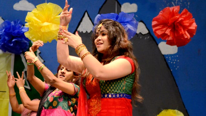 Priya Palkolanu, front, and others dance during a Diwali celebration, the Indian festival of lights, at Claggett Creek Middle School in Keizer on Saturday, Nov. 8, 2014.