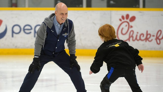 Scott Hamilton and his son Maxx, 8, skate at Ford Ice Center on Oct. 31, 2016.