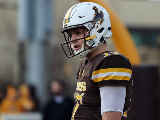 Wyoming Cowboys quarterback Josh Allen (17) warms up