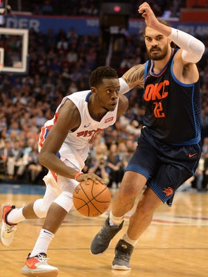 Pistons guard Reggie Jackson (1) drives to the basket against Thunder center Steven Adams (12) during the second quarter on Friday, Nov. 24, 2017, in Oklahoma City.
