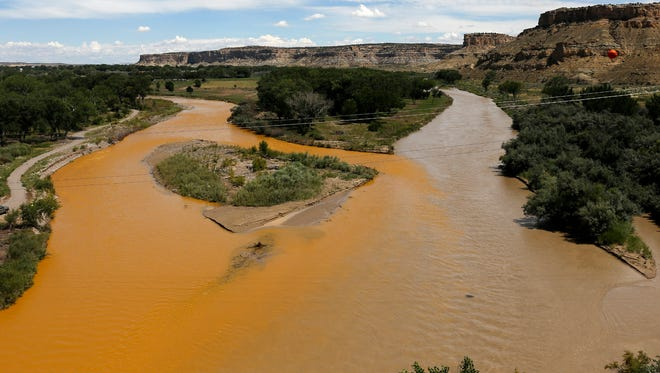 The confluence of the Animas and San Juan rivers is pictured Aug. 8, 2015, in Farmington in the aftermath of the Gold King Mine spill. A run and walk designed to bring attention to the effects of the spill is planned this weekend between Hogback and Shiprock.