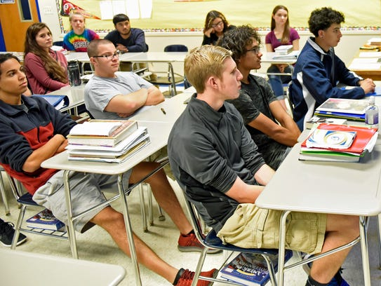 Students watch a film during a civics class at CASHS