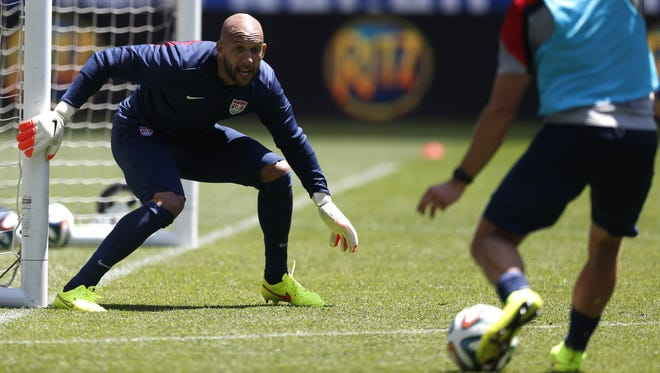 United States goalkeeper Tim Howard, left, defends against teammate Brad Davis during a scrimmage at the team's open workout on May 31 in Harrison, N.J.