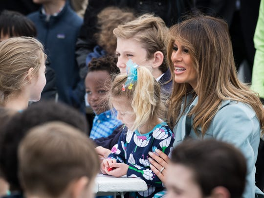 First Lady Melania Trump and son Barron participate