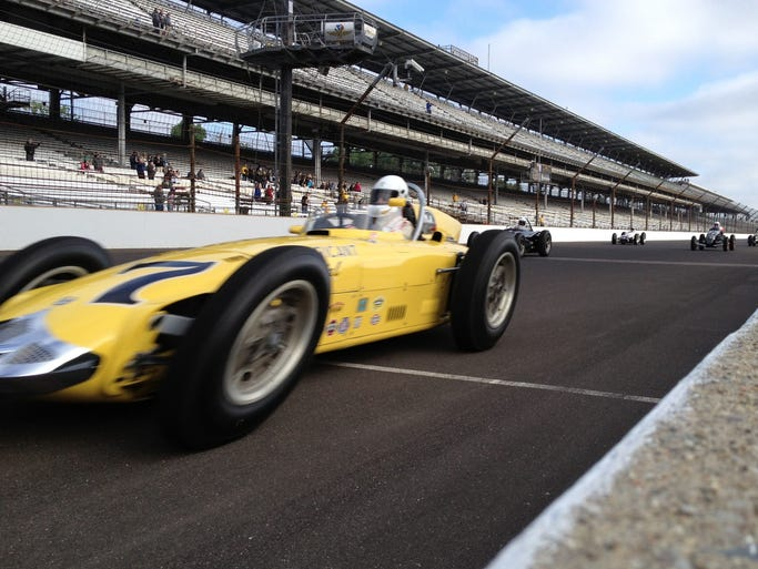 Vintage race cars take to the track at The Indianapolis Motor Speedway. Greg Griffo/ The Star