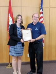State Representative Katrina Shankland presented Library Director Bob Stack with a Citation of Commendation.