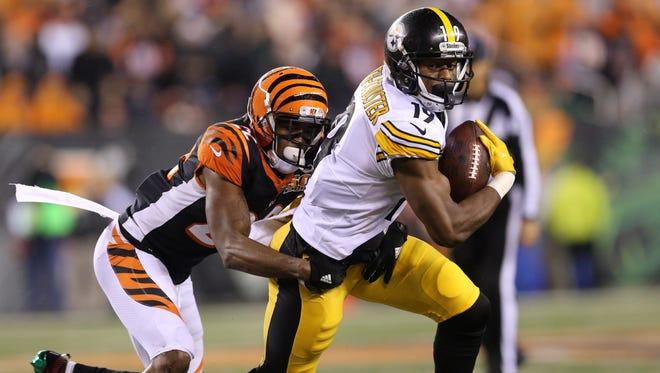 Cincinnati Bengals cornerback William Jackson (22) tackles Pittsburgh Steelers wide receiver JuJu Smith-Schuster (19) in the fourth quarter during the Week 13 NFL game between the Pittsburgh Steelers and the Cincinnati Bengals, Tuesday, Dec. 5, 2017, at Paul Brown Stadium in Cincinnati. Pittsburgh won 23-20.