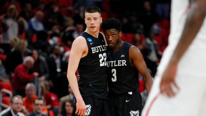 Butler Bulldogs guard Sean McDermott (22) and guard Kamar Baldwin (3) celebrate defeating the Arkansas Razorbacks  in the first round of the 2018 NCAA Tournament at Little Caesars Arena.
