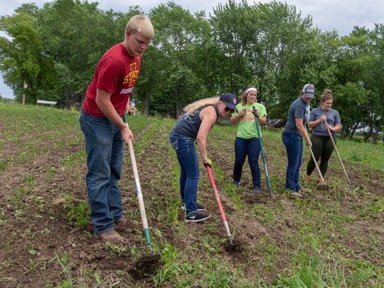 Volunteers from Cargill in Milwaukee prepare the soil