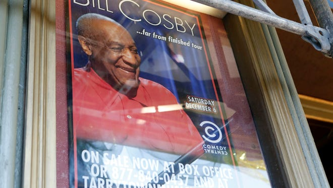 A sign for comedian Bill Cosby's Dec. 6 shows hangs outside the Tarrytown Music Hall, Nov. 20, 2014. Despite recent sex abuse allegations against him the shows are still expected to go on.