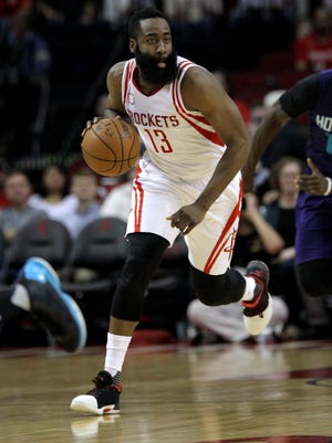 Houston Rockets guard James Harden (13) pushes the ball forward against the Charlotte Hornets during the first quarter at Toyota Center.