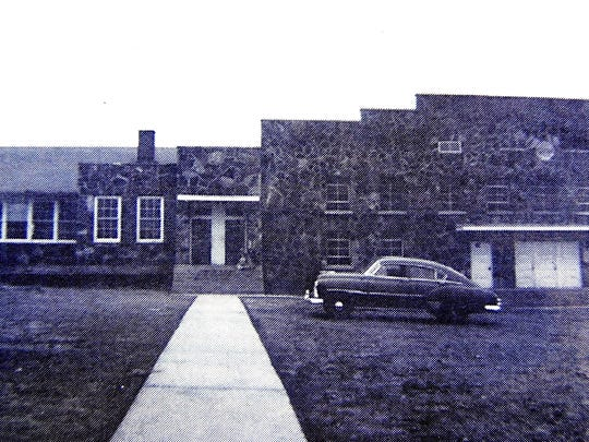 Mountain Home High School and its new gym in 1951. Today, the building is part of Pinkston Middle School.