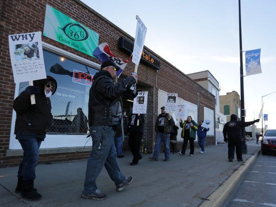 Protesters demand answers in the police shooting death