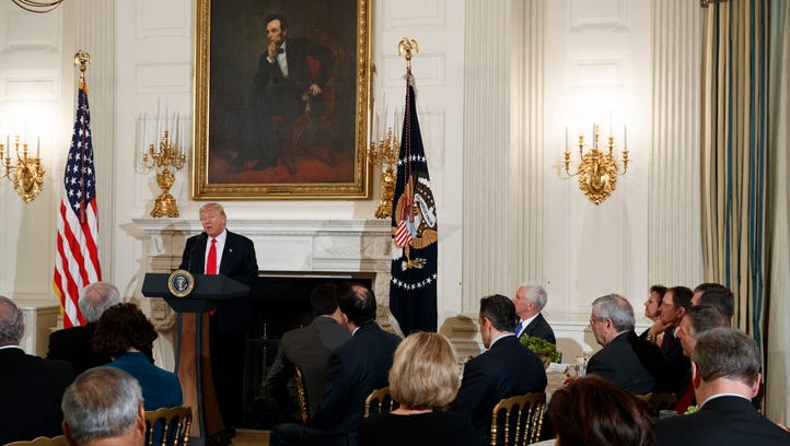President Donald Trump speaks to a meeting of the National