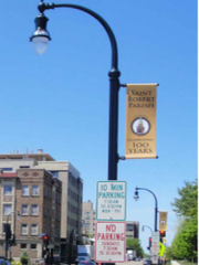 Decorative street lights that arch gracefully over the street are part of the National Avenue beautification plan. The first phase will be done next year.