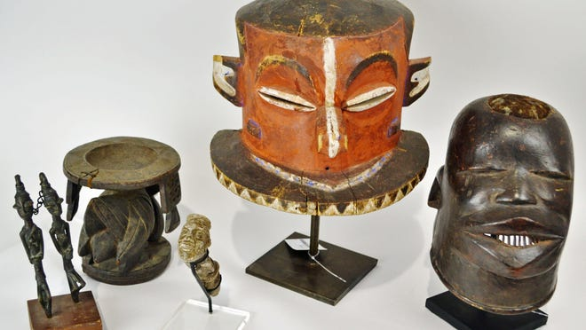 These African art pieces recently sold at EJ's Auction & Consignment.