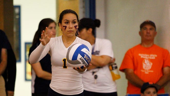Panas' Julianna Bottarini (1) prepares to serve during the 11th Annual Panther Invitational Volleyball Tournament at Walter Panas High School in Cortlandt Manor on Saturday, September 27, 2014.