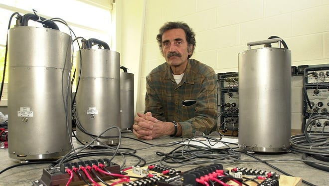 Leanardo Seeber, a seismologist at the Lamont-Doherty Earth Observatory in Palisades with a group of seismometers.