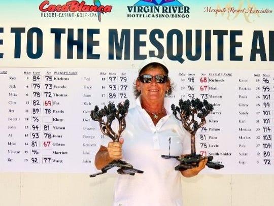 Florida golfer Gigi Higgins holds two trophies after