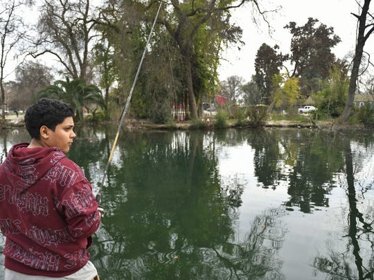 Oscar Espinoza was determined to reel one in while fishing at Mooney Grove Park.