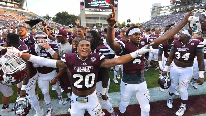 Mississippi State Bulldogs players celebrate after the game against the Northwestern State Demons at Davis Wade Stadium. Mississippi State won 62-13.  Mandatory Credit: Matt Bush-USA TODAY Sports