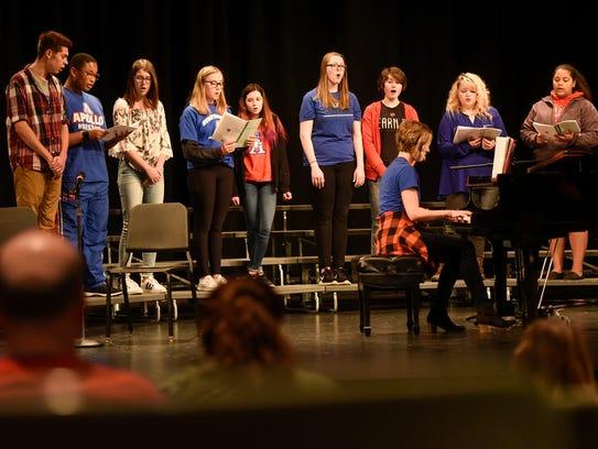 "The Apollo Concert Choir performs ""Earth Song"" during"