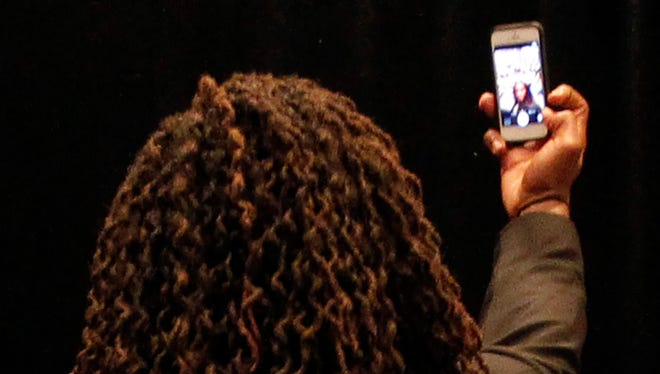 Tennessee linebacker AJ Johnson takes a selfie with the media Tuesday.