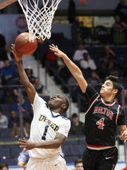 UPrep's J.J. Strothers (1) drives to the basket ahead