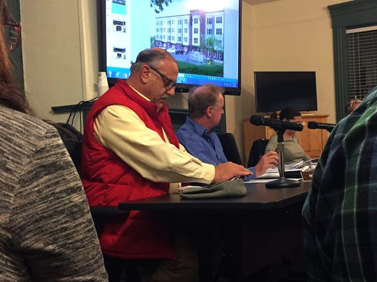 Developer Gabriel Handy, in red vest, participates Thursday night at a meeting of the Essex Junction Planning Commission. Handy's proposal for a four-story, 43-unit apartment building in the village was unanimously approved. Photographed Jan. 4, 2018.