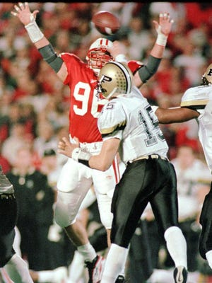 John Favret and Wisconsin's defense withstood 83 pass attempts by Purdue's Drew Brees to win, 31-24, in a game played Oct. 10, 1998, at Camp Randall Stadium.