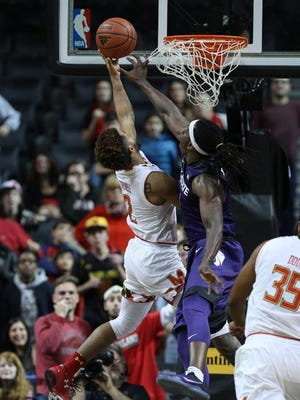 Maryland guard Melo Trimble (2) scores the game-winning basket against Kansas State.