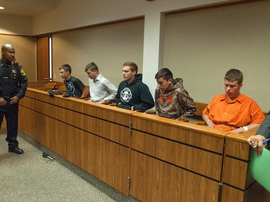 From left, Mark Sekelsky, 16; Trevor Gray, 15; Alexzander Miller, 15; Mikadyn Payne, 16; and Kyle Anger, 17, during their arraignment in District Court in Flint in 2017. Kyle Anger pleaded guilty in October to second-degree murder after throwing a rock from an overpass in Vienna Township that caused the death of Kenneth White.
