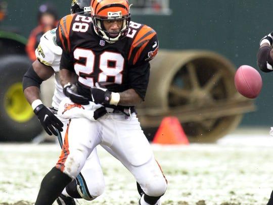 Cincinnati Bengals' Corey Dillon, 28, watches as the