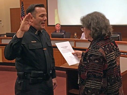 Poulsbo Police Chief Dan Schoonmaker is sworn in by