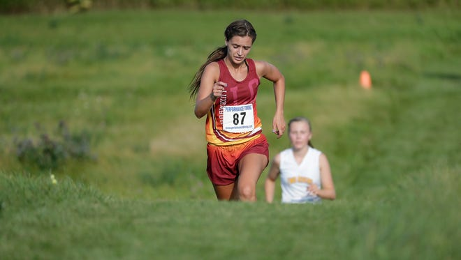 Luxemburg-Casco senior Lizzy Giddley runs up a hill on the course at the Two Rivers Inivte on Thursday. Giddley is one of the returning state runners for the Spartans this season.