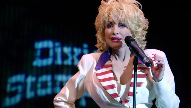 Dolly Parton appears onstage at Dixie Stampede June 18, 2003 in Orlando, Fla. The show has been renamed Dolly Parton's Stampede at all its locations as of Jan. 10, 2018.