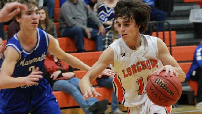 Viola's Gage Harris drives past a Mammoth Spring defender on Monday night at Longhorn Corral.