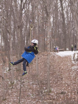 Brogan Fasick didn't quite make it to the other side of the Reptile Run zip line at the Howell Conference and Nature Center. An additional pulley was attached to the line and pulled over to him from the ground with a rope to tow him across the rest of the way.