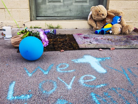 People have dropped off candles, stuffed animals and other mementos at the Phoenix home of Landen Lavarnia, a 9-year-old who was shot on March 20, 2017, and died a day later.