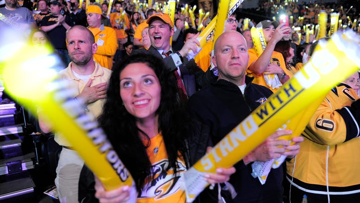 Fans bang their thunder sticks before Game 4 of the NHL first-round series with Anaheim on April 21, 2016 at Bridgestone Arena.
