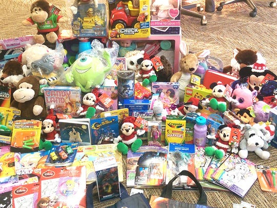 Investment Real Estate Management, LLC collected 299 toys during their annual Toys for Tots drive.