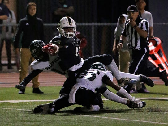 Calabasas wide receiver Nikko Hall, shown scoring a