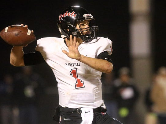 Maryville's quarterback Dylan Hopkins (1) passes the