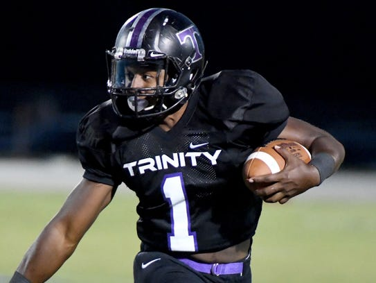 Trinity Christian's Viktor Horton looks down field