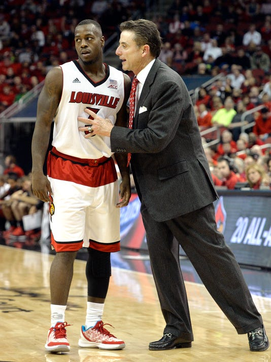 FILE - In this Nov. 14, 2014, file photo, Louisville head coach Rick Pitino, right, talks with Chris Jones during the second half of an NCAA college basketball game against Jacksonville State in Louisville, Ky. Former Louisville basketball player Chris Jones was cleared on rape and sodomy charges Wednesday, April 29, 2015, by a grand jury. The decision came two months after Jones was arrested on allegations that he and two other men sexually assaulted two women, ages 19 and 20, at a party at an off-campus apartment.  (AP Photo/Timothy D. Easley, File)