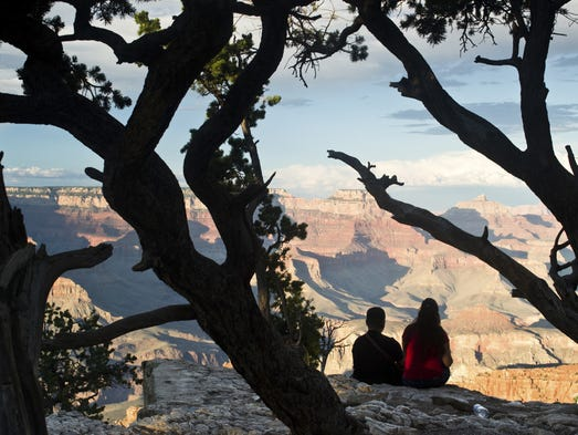 A couple admires the view at Grand Canyon National Park.